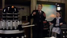 Supreme Renegade Dalek, Ratcliffe, and the Little Girl who Controls the Dalek Battle Computer.