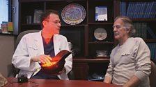 Dr Bob Haber shows Gerry his Light Cap