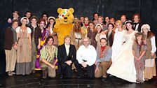 Souvenier photo of Alexandra and Pudsey with the cast