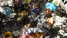 Oyster preparation in Gambian village