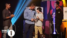 George receives his Teen Hero award from Dev, Louis Smith and Dylan Hartley