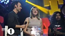 Jenna receives her Teen Hero award from Aled and Misha B