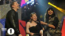 Chelsea receives her Teen Hero award from Professor Green and Jameela Jamil