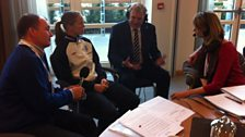 Sir Trevor Brooking takes calls at St Georges Park