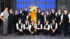 Pudsey and Geri with the cast of Singin' in the Rain