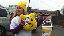 Louise from BBC Children in Need shakes a bucket