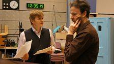 Director Sasha Yevtushenko discusses a scene with Paul Rhys