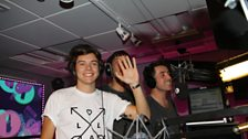 Harry Styles, Example and Grimmy about to begin George Michael karaoke