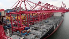 A container ship can now be loaded in just hours, compared to weeks for the older cargo ships.