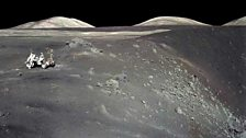 Astronauts Cernan and Schmitt on a crater edge in Taurus-Littrow