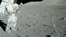 Harrison Schmitt taking geological data in the lunar field