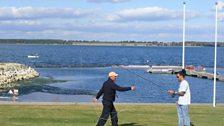 Dev under the watchful eye of Hywel the expert fisherman