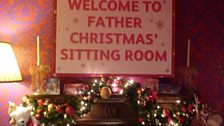 Dev is invited to Father Christmas' sitting room
