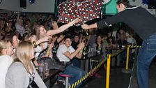 The crowd sourced an umbrella for Aled's song...