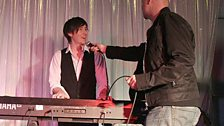 Dom thrusts the microphone at Matt Fincham who has somehow ended up on keyboards