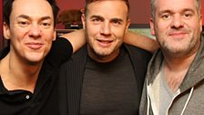 Gary Barlow congratulates Chris and Dave and presents them with their official Guinness certificate.
