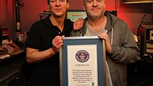 Chris and Dave receive their official certificate from Guiness for the Longest Marathon Radio Show.