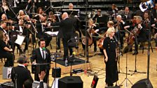 She did a special version of All About Tonight with the orchestra, lyrics adapted for Chris