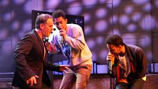 Rizzle Kicks perform on stage. Chris joins in for a dance!