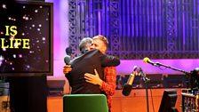Man hugs with Gary Barlow