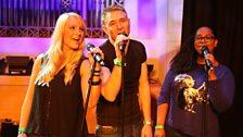 Chris' jingle singers, singing