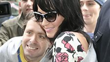 Katy poses for photos with fans