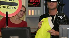 Scott and Beccy get the Lollipop lady outfit ready
