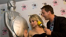 Scott presents Duffy with her very own giant Brit Award, but how's she going to get it home?