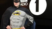 After a hard-days work fighting crime, Chris returns to the studio
