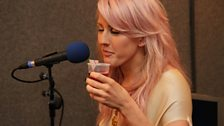 She tries one of Beccy's cocktails - basically just cranberry juice!