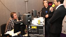Robbie and Jason from Take That pop into Scott's makeshift studio