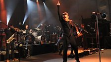 Robbie Williams performing live