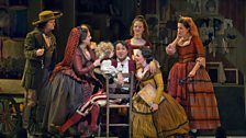 Rodion Pogossov as Figaro with the Chorus of The Metropolitan Opera, New York