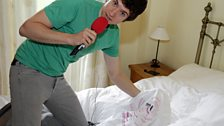 Greg on a house tour showing us his bed and the Radio 1 t-shirt he sleeps in