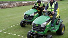 It's a nail-biting dash to the finish line as Dave beats Greg in the Lawnmower Racing final!