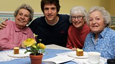 Three of the very lovely residents - Maureen, Muriel and Edna - join Greg over some tea and cakes!