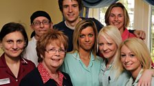 The care home staff get cosy with Greg. Hearts of gold every one!