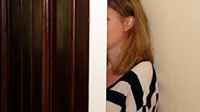 Who's hiding behind this door?