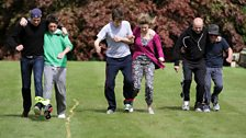 The three-legged race gets underway, with Vernon and Matt, Greg and Sam, Dom and Dave amongst the competitors.