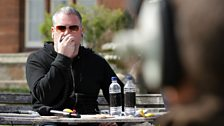 Chris Moyles on the mic in the commentary box.