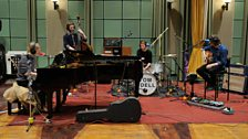 Tom Odell performs with his band