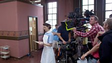 Jessica Raine is filming a scene in the Parish Hall and...