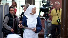Jenny Agutter prepares to film a scene whilst...