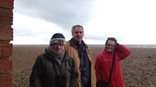 Felicity Evans with Richard Porter and Richard Aspinall on the Norfolk Coast close to Cley Marshes.