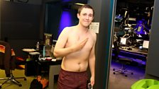Chris Stark travels the BBC lift in his pants for Comic Relief