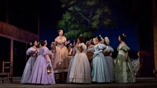 """Anne-Carolyn Bird (on platform) as Giannetta in Donizetti's """"L'Elisir d'Amore."""""""