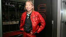 The 'French Spiderman' Alain Robert in a snazzy suit