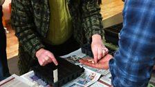 Ady helps sew seeds