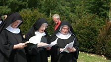 Singing in the grounds of Stanbrook Abbey. Copyright Stanbrook Abbey.