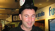 BBC engineer Eugene Sully shows off his fetching vinyl headgear!